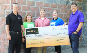 4 people holding the large wefixu scholarship cheque