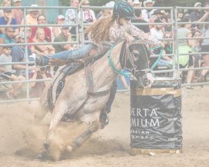 girl doing rodeo competition