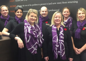 staff wearing purple scarf for fundraising